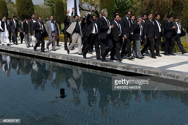 Lawyers of Pakistan People's party march to the site of the hanging of former premier Zulfikar Ali Bhutto on his 35th death anniversary at Jinnah...