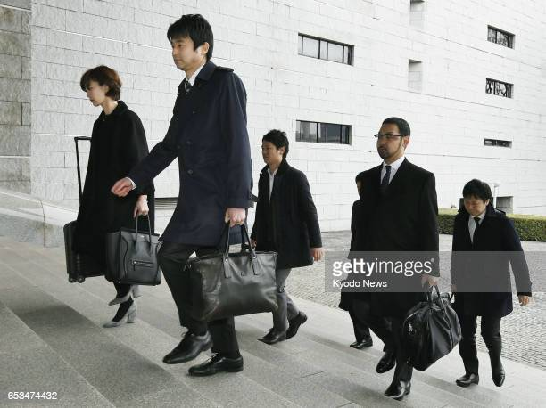 Lawyers representing a 45yearold man indicted over theft cases arrive at the Supreme Court in Tokyo on March 15 to hear its ruling Regarding the...