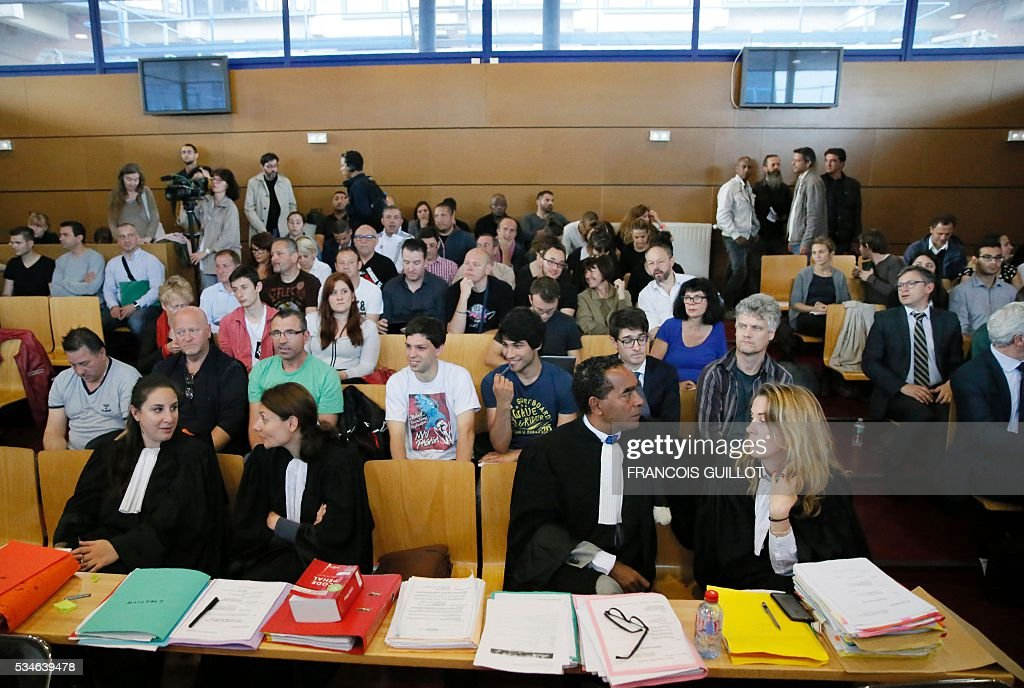 Lawyers sit at the court of Bobigny, northern Paris on May 27, 2016 at the beginning of the trial of 15 French CGT union's members judged for the episode of the torn shirt, in full showdown initiated by the union with the government on labor law. On October 5, 2015 under the cries of naked, naked and resignation , the Air France human resources director found himself shirtless, tattered shirt during a protest after the announcement of a restructuring of the airline threatening nearly 3,000 jobs.