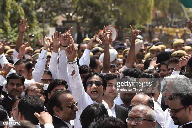 Lawyers stage a demonstration to oppose the Bar Council of India's suggestion to the Law Commission to ban strikes by advocates on March 23 2017 in...