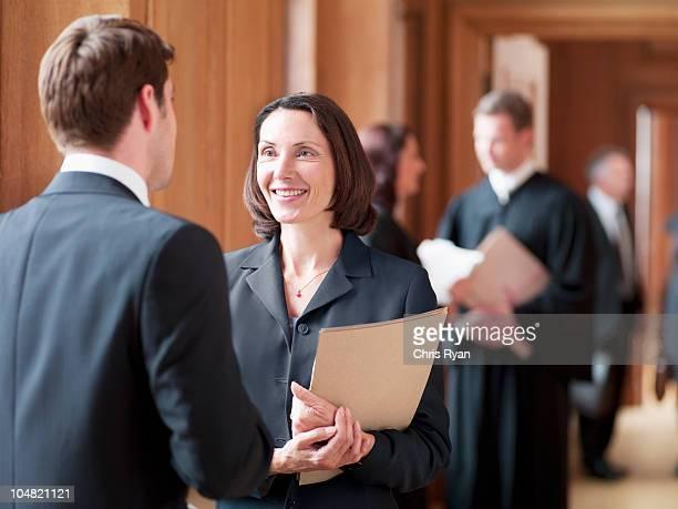 Lawyers talking in corridor