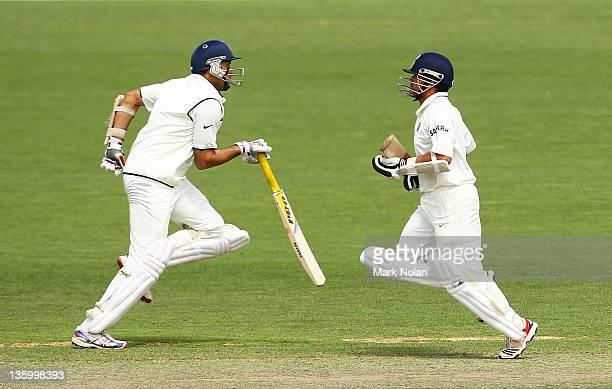 Laxman of India and Sachin Tendulkar run between the wickets during day two of the International Tour match between India and the Cricket Australia...