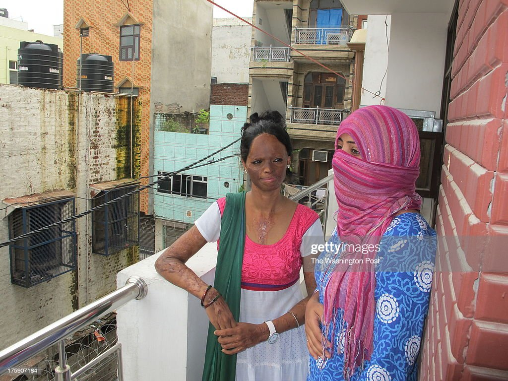 Laxmi Aggarwal (23), and Nasreen (one name, 33) in the balcony of the new campaign office Stop Acid Attacks in New Delhi. Aggarwal was only 16 when a man threw acid on her face and hands for refusing his proposal. She remained hidden behind the veil for many years. But this year, buoyed by the anti-rape protests and a new law against acid attacks, Aggarwal found the courage to come out and join the campaign. Since then she has become a sort of the poster-child of the campaign against acid attacks.  For the first time, India established specific penalties for the crime, and now the Supreme Court  directed the government two weeks ago to regulate acid sales and award quick money for medical treatment for the survivors. Not to lose on the momentum generated by the anti-rape activism and the new law, acid attack survivors are now coming together to push the government to enforce the court's orders, demand rehabilitation and planning street plays to raise awareness about the prevalence of the crime in Indian cities. 'It is very important to show the face, people should see the horror. Hiding the face is the same as staying silent,' Aggarwal said.
