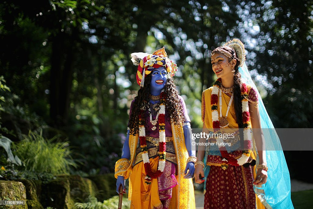 Laxmipriya Patel (L), aged 20, dressed as the Hindu god Lord Krishna, and her sister Mohini Patel, aged 13, dressed as Lord Krishna's devotee Radharani, walk through the George Harrison Memorial Garden during the Janmashtami Hindu Festival at Bhaktivedanta Manor on August 28, 2013 in Watford, England. Up to 72,000 were expected to take part in the Hindu festival of 'Janmashtami', which falls on August 28 this year, and marks the birth of the Hindu god Lord Krishna. The festival is believed to be the largest Hindu festival gathering outside of India. Bhaktivedanta Manor is also celebrating it's 40th year since the manor house was donated to the Society of Krishna Consciousness by George Harrison in 1973.