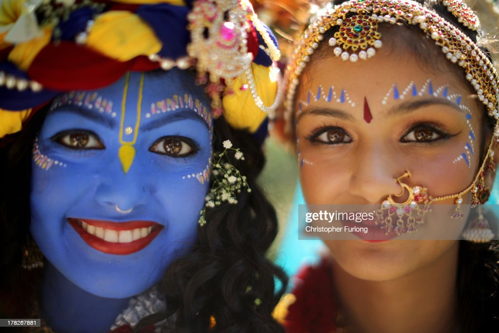 Laxmipriya Patel (L), aged 20, dressed as the Hindu god Lord Krishna, poses with her sister Mohini Patel, aged 13, dressed as Lord Krishna's devotee Radharani, during the Janmashtami Hindu Festival at Bhaktivedanta Manor on August 28, 2013 in Watford, England. Up to 72,000 were expected to take part in the Hindu festival of 'Janmashtami', which falls on August 28 this year, and marks the birth of the Hindu god Lord Krishna. The festival is believed to be the largest Hindu festival gathering outside of India. Bhaktivedanta Manor is also celebrating it's 40th year since the manor house was donated to the Society of Krishna Consciousness by George Harrison in 1973.