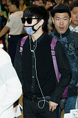 Lay of boy band EXOM is seen on departure at Gimpo International Airport on October 3 2014 in Seoul South Korea