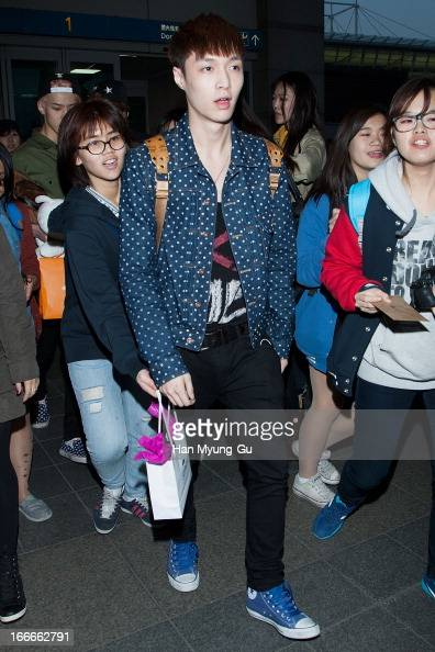 Lay of boy band EXOM is seen upon arrival from China at Incheon International Airport on April 15 2013 in Incheon South Korea