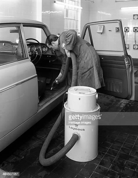 Laycock Vacacar vacuum cleaner in use at an Esso garage Sheffield South Yorkshire 1965 In addition to their wide range of vehicle lifts and testing...