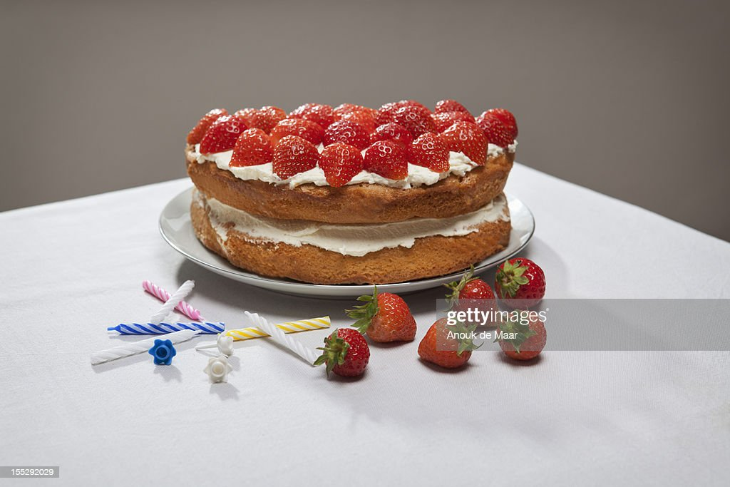 Layer cake with cream and strawberries : Stock Photo