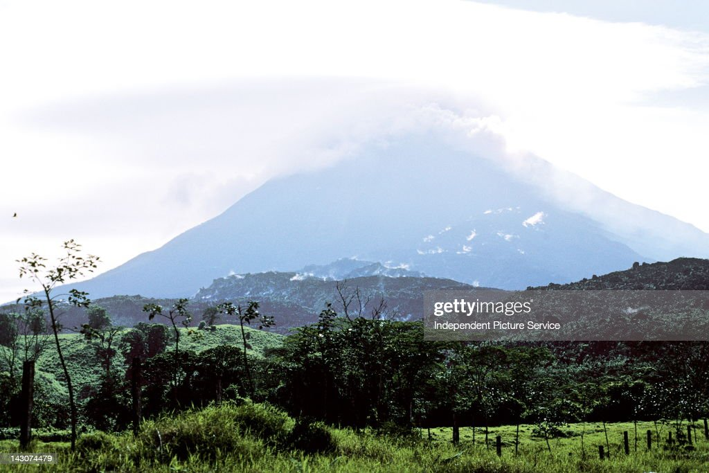 A layer of clouds hanging over Volcan Arenal, Costa Rica's most active volcano.