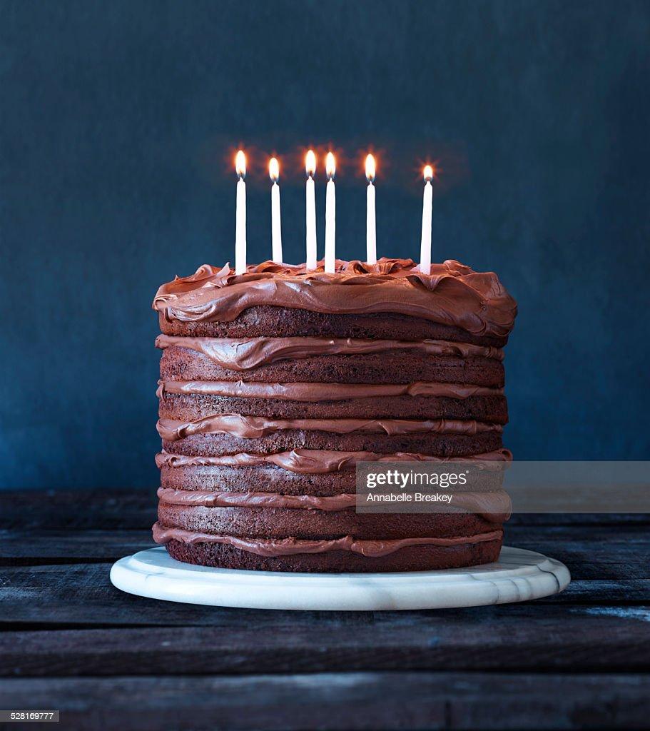 Layered Chocolate Birthday Cake With Candles Stock Photo