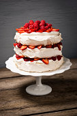 Pavlova is a cake-like dessert, popular in New Zealand and Australia, and made up of layers of meringue, whipped cream and fresh fruit.