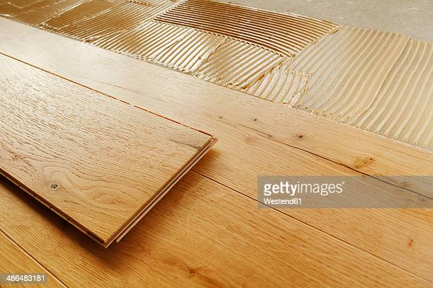 Laying finished oak parquet flooring, close-up