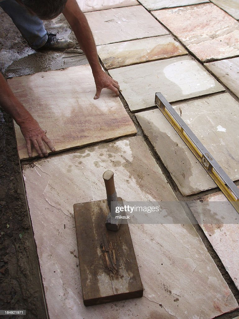 Laying Patio Flag Paving Slab : Stock Photo