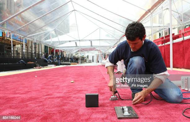 Laying red carpet outside the Kodak Theatre in Hollywood Boulevard Los Angeles where the 80th Academy Awards are set to be staged on Sunday 24th...