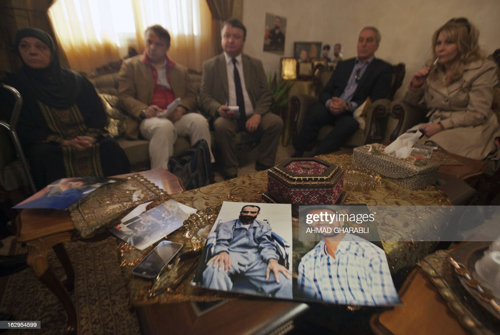 Layla Issawi (L), the mother of hunger-striking Palestinian prisoner Samer Issawi, meets with European politicians from the Council for European Palestinian Relations, (L to R) Niccolo Rinaldi of Italy, Jim Hume of Scotland, Pat Sheehan of Ireland and Pauline McNeill of Scotland, at her home in the Arab east Jerusalem neighbourhood of Issawiya, on March 2, 2013. The European lawmakers were in the region in a show of support for Palestinian detainees on hunger strike in Israeli prisons.