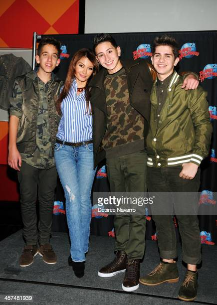 Layla Kayleigh poses with Jason Smith Mikey Fusco and Madison Alamia of To Be One at Planet Hollywood Times Square on December 17 2013 in New York...