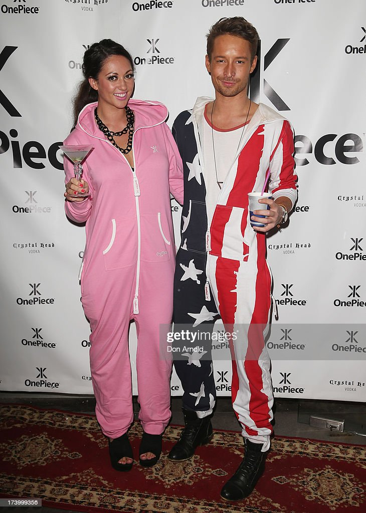 Layla Subritzky and Simon Hancock pose during the OnePiece onesie Australian launch at the Bucket List at the Bondi Beach on July 19, 2013 in Sydney, Australia.