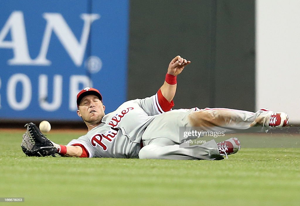 <a gi-track='captionPersonalityLinkClicked' href=/galleries/search?phrase=Laynce+Nix&family=editorial&specificpeople=214636 ng-click='$event.stopPropagation()'>Laynce Nix</a> of the Philadelphia Phillies cannot catch the ball hit Zack Cozart of the Cincinnati Reds in the 8th inning at Great American Ball Park on April 15, 2013 in Cincinnati, Ohio. All uniformed team members are wearing jersey number 42 in honor of Jackie Robinson Day. The Reds won 4-2.