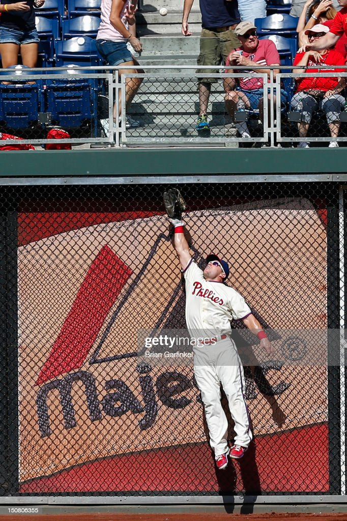 <a gi-track='captionPersonalityLinkClicked' href=/galleries/search?phrase=Laynce+Nix&family=editorial&specificpeople=214636 ng-click='$event.stopPropagation()'>Laynce Nix</a> #19 of the Philadelphia Phillies jumps to catch a ball in the seventh inning of the game against the Washington Nationals at Citizens Bank Park on August 26, 2012 in Philadelphia, Pennsylvania. The Phillies won 4-1.