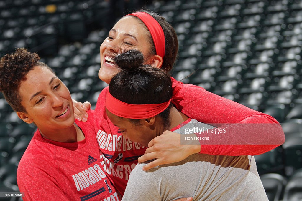 Layshia Clarendon #5, Natalie Achonwa #11 and Briann January #20 of the Indiana Fever smile and warm up before Game Two of the WNBA Eastern Conference Semifinals against the Chicago Sky at Bankers Life Fieldhouse on September 19, 2015 in Indianapolis, Indiana.