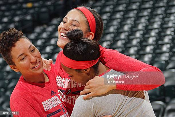 Layshia Clarendon Natalie Achonwa and Briann January of the Indiana Fever smile and warm up before Game Two of the WNBA Eastern Conference Semifinals...