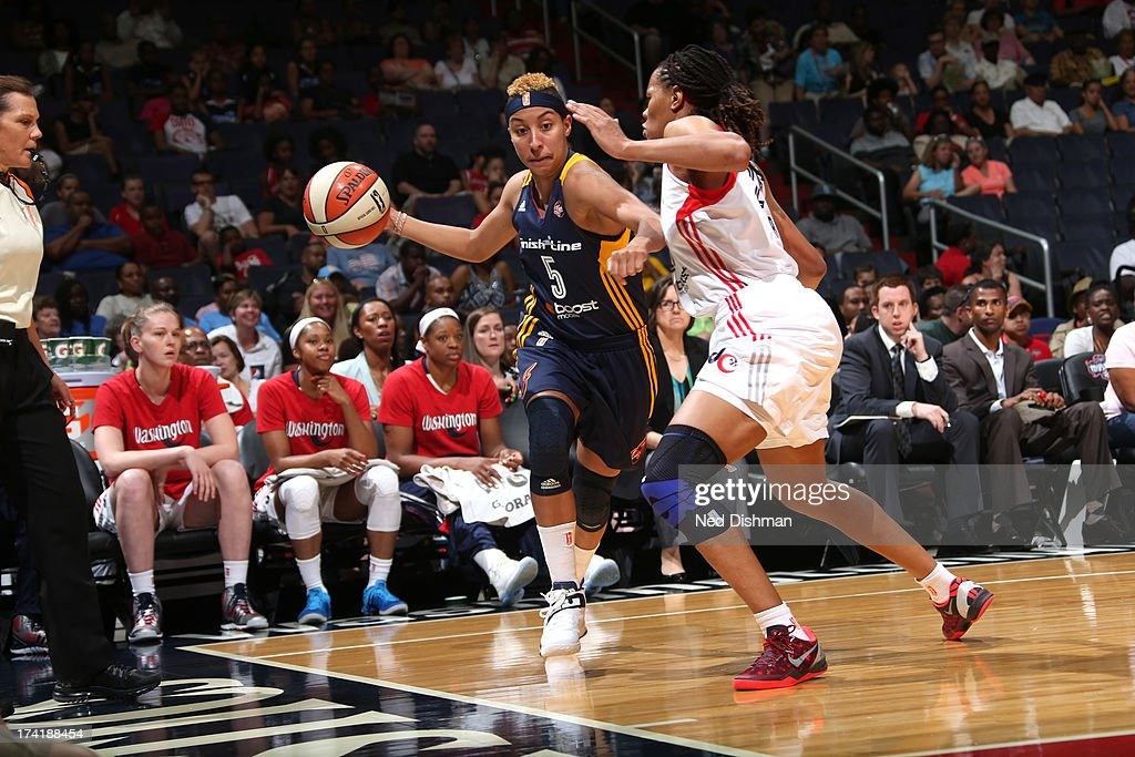 <a gi-track='captionPersonalityLinkClicked' href=/galleries/search?phrase=Layshia+Clarendon&family=editorial&specificpeople=10666159 ng-click='$event.stopPropagation()'>Layshia Clarendon</a> #5 of the Indiana Fever drives against <a gi-track='captionPersonalityLinkClicked' href=/galleries/search?phrase=Monique+Currie&family=editorial&specificpeople=553598 ng-click='$event.stopPropagation()'>Monique Currie</a> #25 of the Washington Mystics at the Verizon Center on July 21, 2013 in Washington, DC.