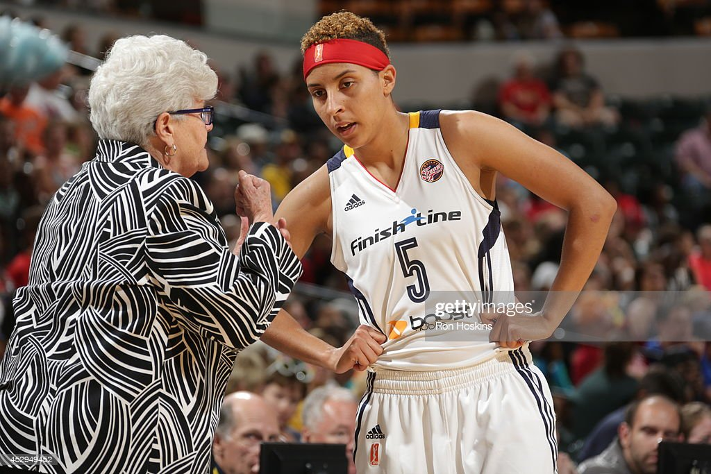 <a gi-track='captionPersonalityLinkClicked' href=/galleries/search?phrase=Layshia+Clarendon&family=editorial&specificpeople=10666159 ng-click='$event.stopPropagation()'>Layshia Clarendon</a> #5 of the Indiana Fever listens to Head Coach, <a gi-track='captionPersonalityLinkClicked' href=/galleries/search?phrase=Lin+Dunn&family=editorial&specificpeople=592589 ng-click='$event.stopPropagation()'>Lin Dunn</a>, during the game against the Los Angeles Sparks on July 15, 2014 at Bankers Life Fieldhouse in Indianapolis, Indiana.