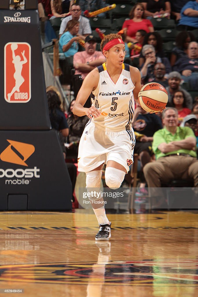 Layshia Clarendon #5 of the Indiana Fever moves the ball up-court against the Los Angeles Sparks on July 15, 2014 at Bankers Life Fieldhouse in Indianapolis, Indiana.