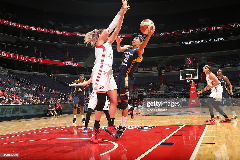 Layshia Clarendon #5 of the Indiana Fever shoots against Stefanie Dolson #31 of the Washington Mystics in Game Two of the Eastern Conference Semifinals during the 2014 WNBA Playoffs on August 23, 2014 at the Verizon Center in Washington, DC.