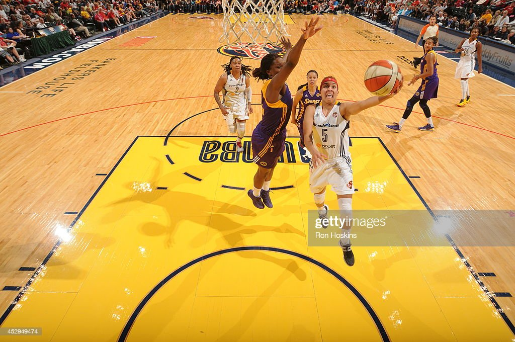 <a gi-track='captionPersonalityLinkClicked' href=/galleries/search?phrase=Layshia+Clarendon&family=editorial&specificpeople=10666159 ng-click='$event.stopPropagation()'>Layshia Clarendon</a> #5 of the Indiana Fever shoots against the Los Angeles Sparks on July 15, 2014 at Bankers Life Fieldhouse in Indianapolis, Indiana.