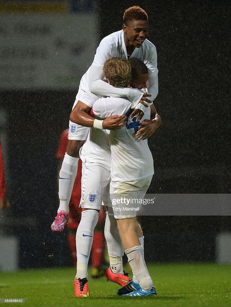 Layton Ndukwu of England celebrates scoring their first goal with Jahmal Hector-Ingram and Tom Davies of England during the Under 17 International match between England U17 and Portugal U17 at Proact Stadium on August 29, 2014 in Chesterfield, England.
