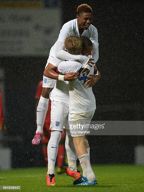 Layton Ndukwu of England celebrates scoring their first goal with Jahmal HectorIngram and Tom Davies of England during the Under 17 International...