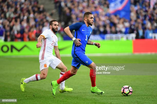 Layvin Kurzawa of France and Daniel Carvajal of Spain during the friendly match between France and Spain at Stade de France on March 28 2017 in Paris...