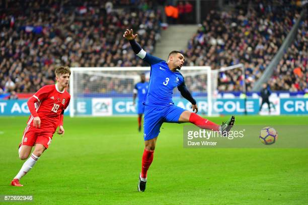 Layvin Kurzawa of France and David Brooks of Wales during the international friendly match between France and Wales at Stade de France on November 10...