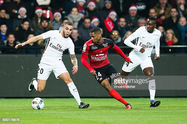 Layvin Kurzawa of Paris Saint Germain and Marcus Coco of Guingamp during the French Ligue 1 match between Guingamp and Paris Saint Germain at Stade...