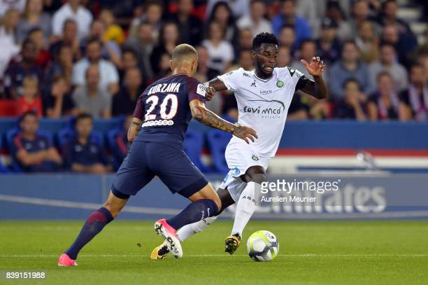 Layvin Kurzawa of Paris SaintGermain and Habib Maiga of AS Saint Etienne fight for the ball during the Ligue 1 match between Paris SaintGermain ans...