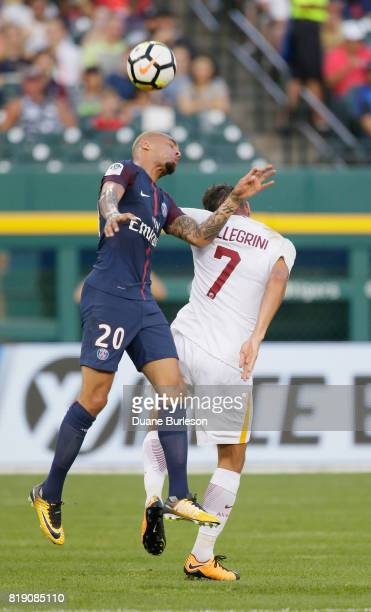 Layvin Kurzawa of Paris SaintGermain heads the ball away from Lorenzo Pellegrini of AS Roma during the first half at Comerica Park on July 19 2017 in...