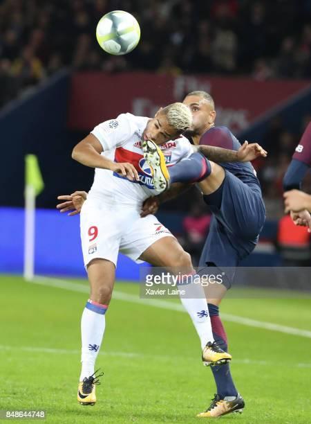 Layvin Kurzawa of Paris SaintGermain in action with Mariani Diaz of Olympique Lyonnais during the French Ligue 1 match between Paris Saint Germain...