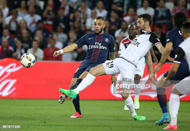 Layvin Kurzawa of PSG and Christophe Kerbrat of Guingamp in action during the French Ligue 1 match between Paris SaintGermain and En Avant Guingamp...