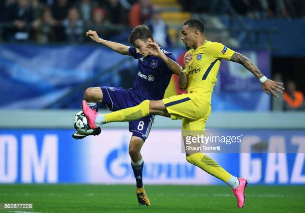 Layvin Kurzawa of PSG and Pieter Gerkens of RSC Anderlecht battle for possession during the UEFA Champions League group B match between RSC...