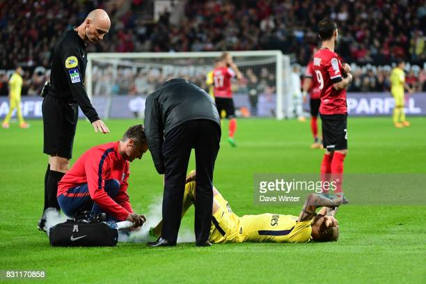 Layvin Kurzawa of PSG goes down injured during the Ligue 1 match between EA Guingamp and Paris Saint Germain at Stade du Roudourou on August 13 2017...