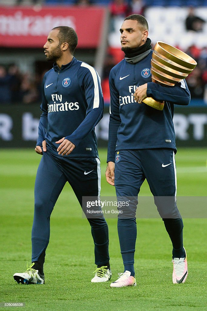 Layvin KURZAWA of PSG with the League Cup Trophy during the French Ligue 1 match between Paris Saint Germain PSG and Stade Rennais at Parc des Princes on April 29, 2016 in Paris, France.