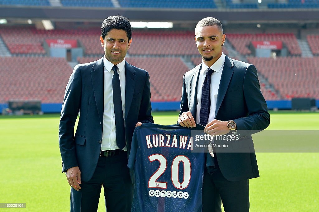 Layvin Kurzawa poses with his new jersey next to Nasser Al-Khelaifi, President of PSG, during his presentation to the media at Parc des Princes on August 28, 2015 in Paris, France. Layvin Kurzawa signed a five years contract with the Paris Saint Germain.