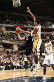 Lazar Hayward of the Minnesota Timberwolves shoots against Danny Granger of the Indiana Pacers on February 11 2011 at Conseco Fieldhouse in...