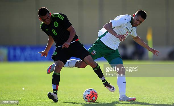 Lazar Marin of Bulgaria is tackled by Alvarez Lopez of Mexico during the Toulon Tournament match between Bulgaria and Mexico at Stade Perruc on May...