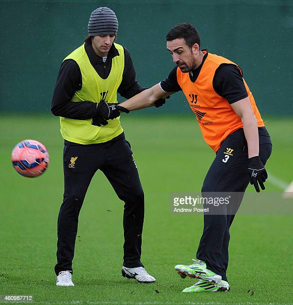 Lazar Markovic and Jose Enrique of Liverpool in action during a training session at Melwood Training Ground on January 3 2015 in Liverpool England