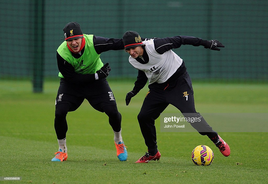 Lazar Markovic and Martin Skrtel of Liverpool during a training session at Melwood Training Ground on November 21, 2014 in Liverpool, England.