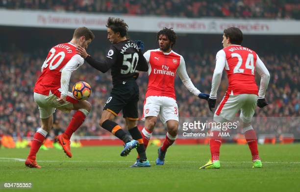 Lazar Markovic of Hull City battles with Shkodran Mustafi Mohamed Elneny and Hector Bellerin of Arsenal during the Premier League match between...