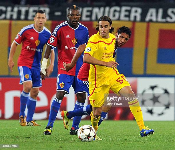 Lazar Markovic of Liverpool competes with Mohamed Elneny of FC Basel 1893 during the UEFA Champions League match between FC Basel 1893 and Liverpool...